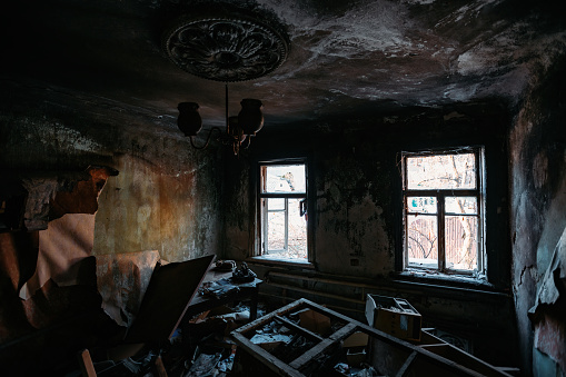 Burnt old house interior. Consequences of fire