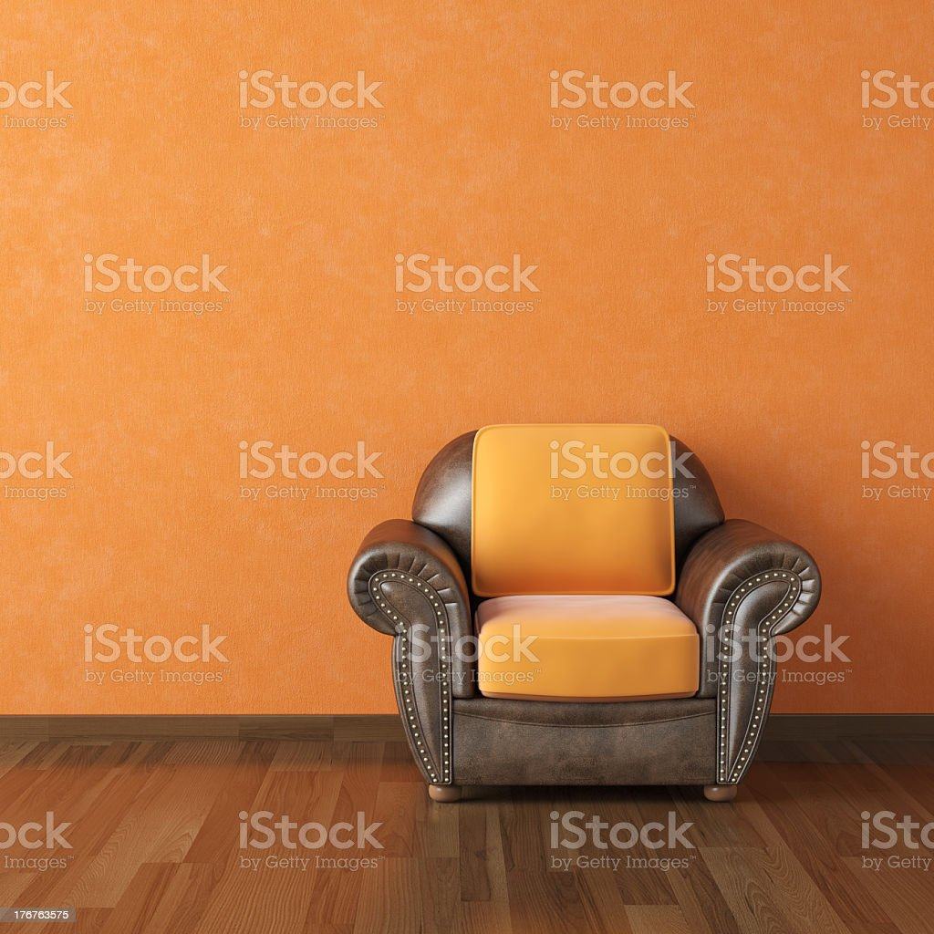 A burnt orange interior design and chair royalty-free stock photo