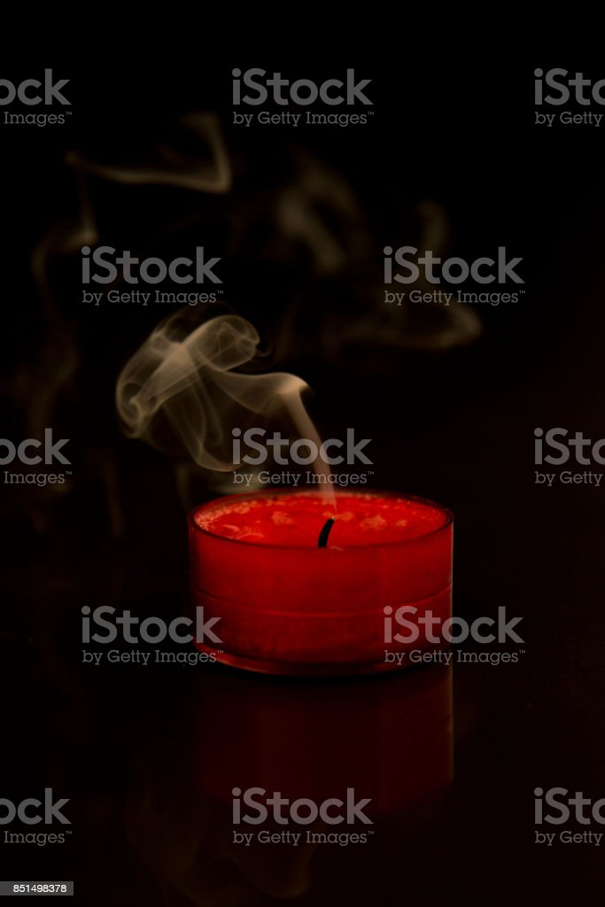 Burnt out candle stock photo
