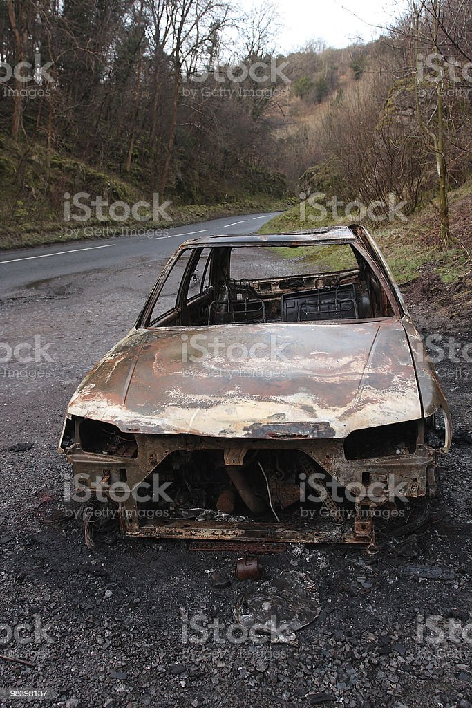 Burnt out car wreck royalty-free stock photo