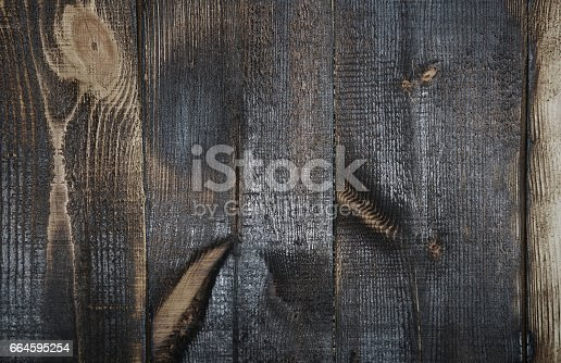 470521655istockphoto Burnt out wooden plans 664595254