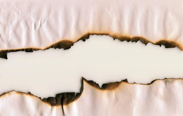fondo de marco de papel quemado - quemar fotografías e imágenes de stock