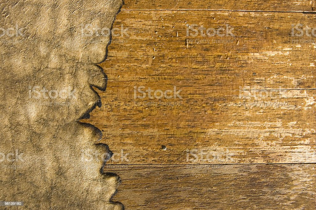 Burnt Paper on wethered wooden texture royalty-free stock photo