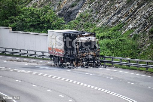 1015604922 istock photo Burnt truck on the highway. The car after the fire 869901894