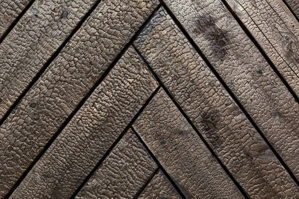 Burnt wooden board texture. Sho-Sugi-Ban Yakisugi is a traditional Japanese method of wood preservation. stock photo