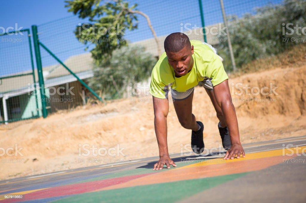 Burpees at the playground stock photo