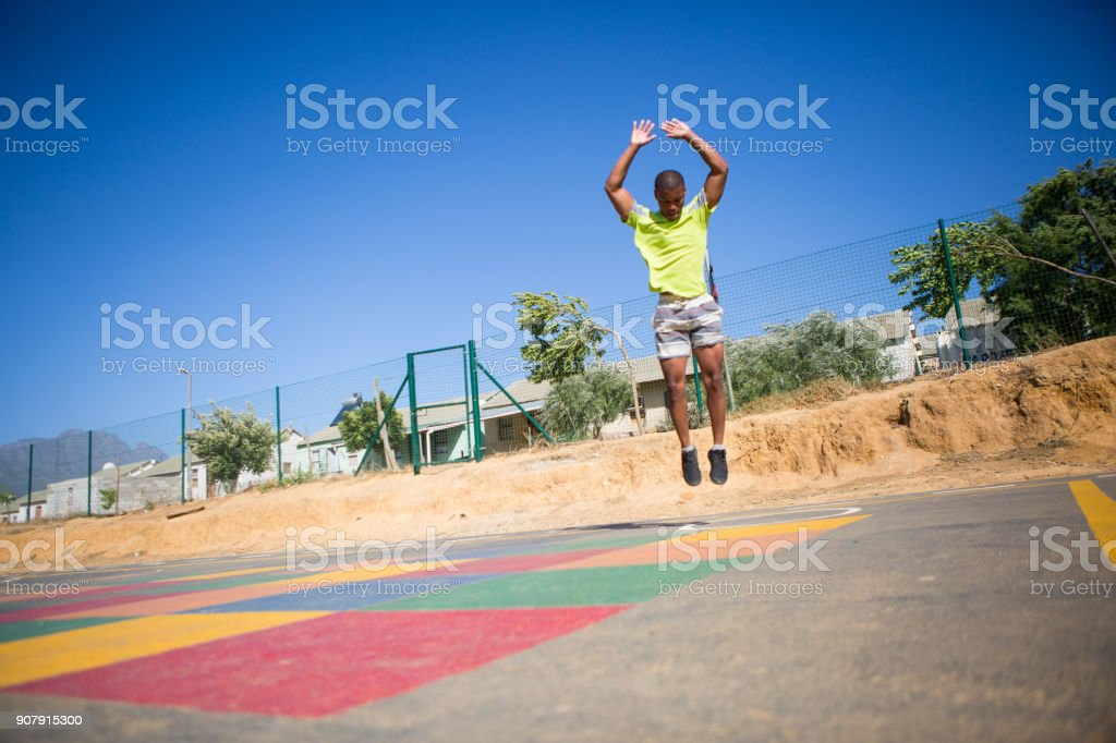 Burpees outside at the playground stock photo