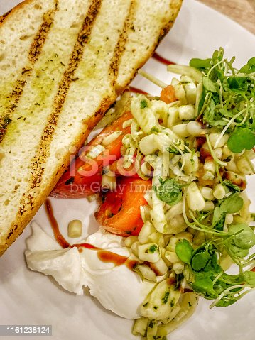Burrata cheese salad with a variety of vegetables