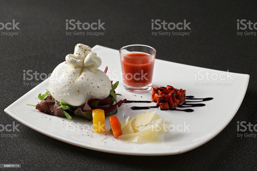 Burrata cheese with strawberry gazpacho sauce stock photo