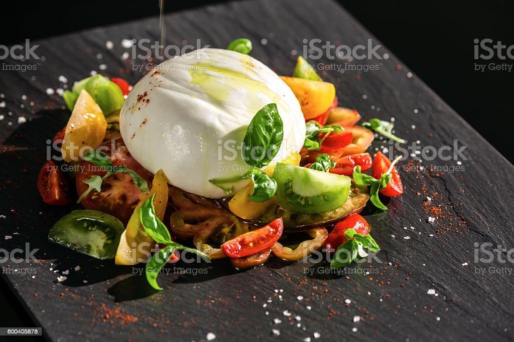 Burrata mit Heirloom tomato stock photo