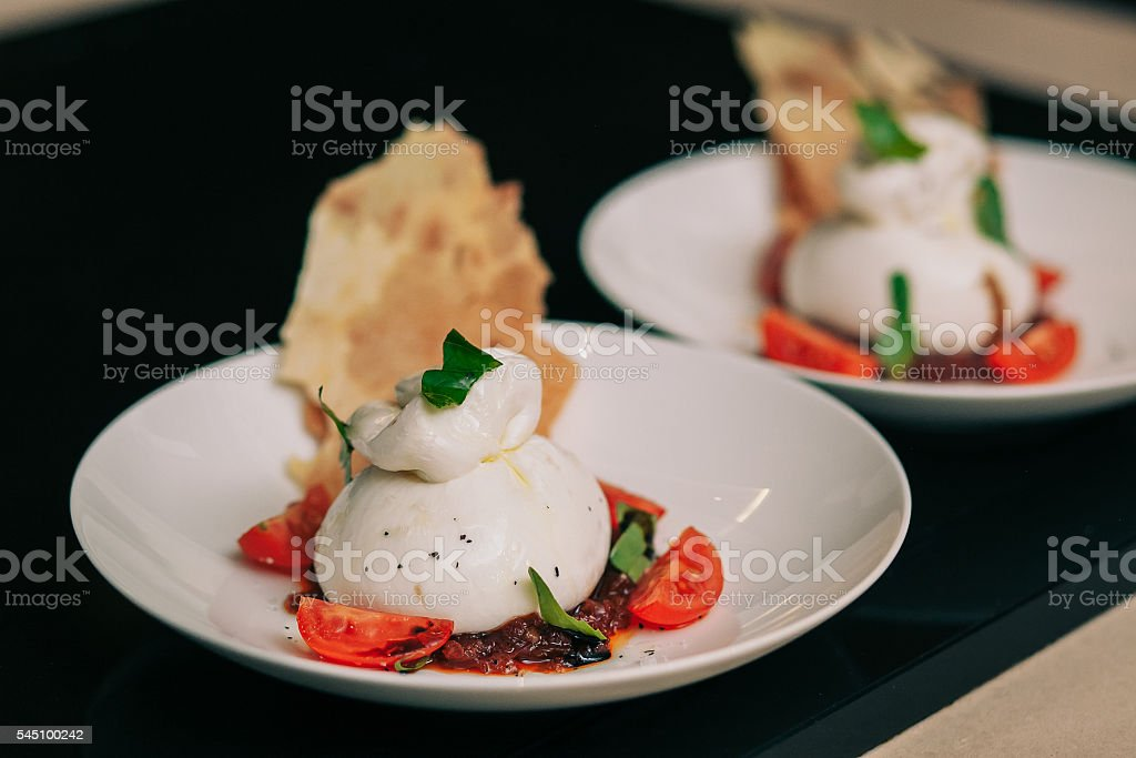 Burrata mozzarella with tomato tartare stock photo