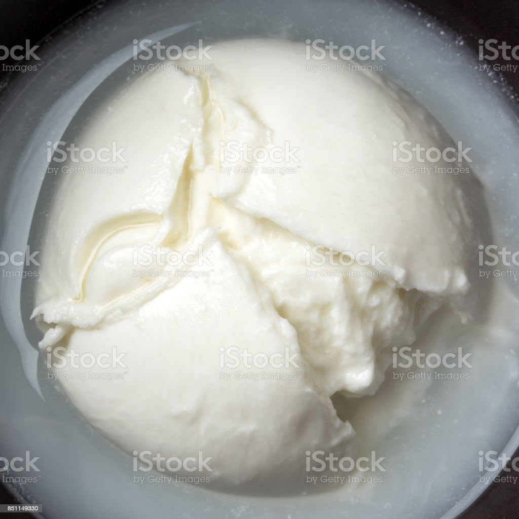 Burrata (fresh Italian cheese made from mozzarella and cream) over focaccia stock photo