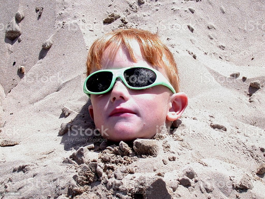Burried in Sand royalty-free stock photo