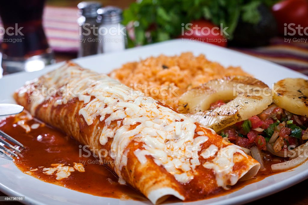 Burritos with red sauce stock photo