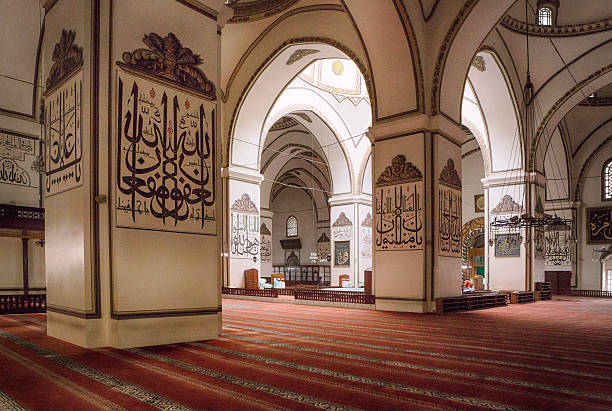 Bursa Grand Mosque, Turkey Bursa Grand Mosque or Ulu Cami was built between 1396 and 1399. The medieval drawings on the columns are arabic scripts which are words and verses from holy Quran. grand mosque stock pictures, royalty-free photos & images
