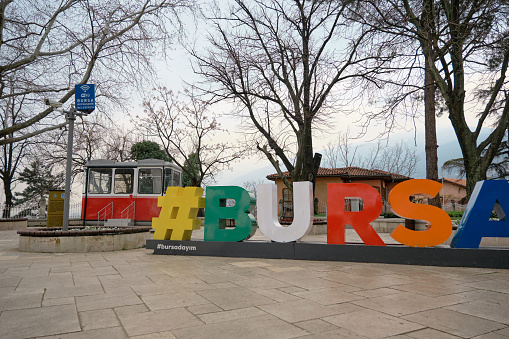 bursa tophane square during overcast and cloudy day with colorful BURSA with hashtag symbol.
