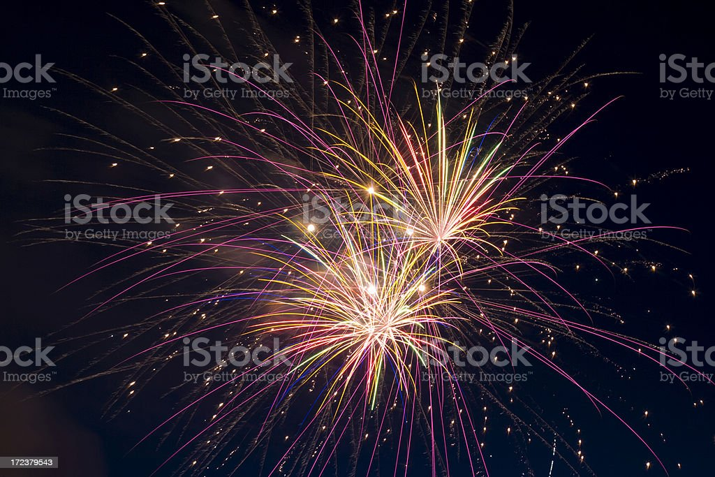 Burst of colorful fireworks against night sky royalty-free stock photo