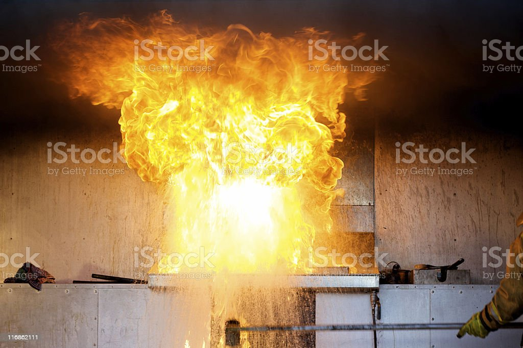 Burst of flame from water onto oil fire demonstration royalty-free stock photo