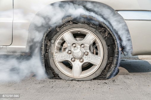 istock burst tire on the road 670291390