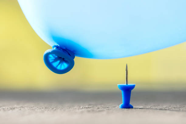 Burst your bubble thumbtack and balloon background stock photo
