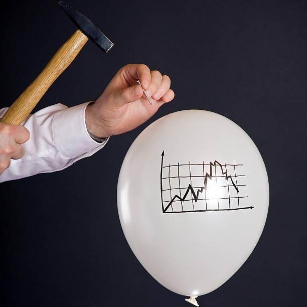 bursting the financial bubble stock photo