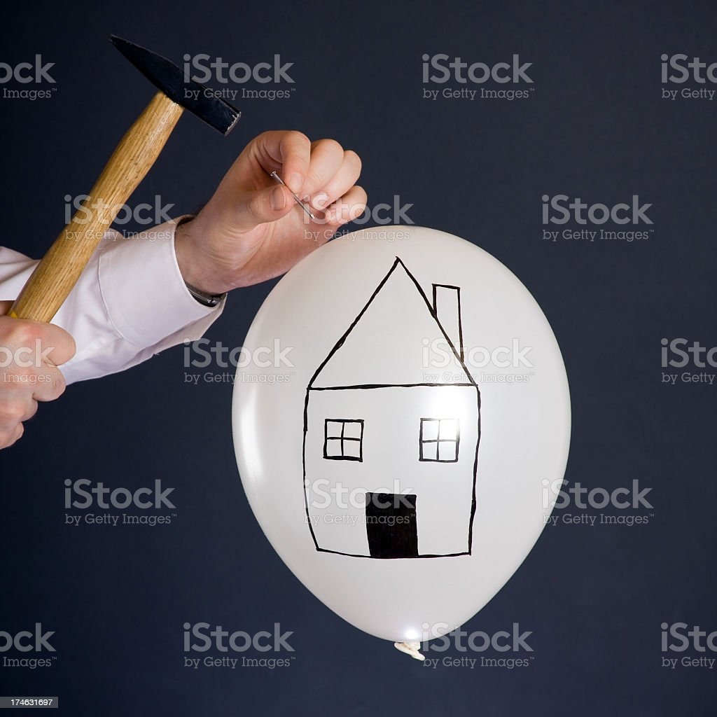 bursting the real estate bubble royalty-free stock photo