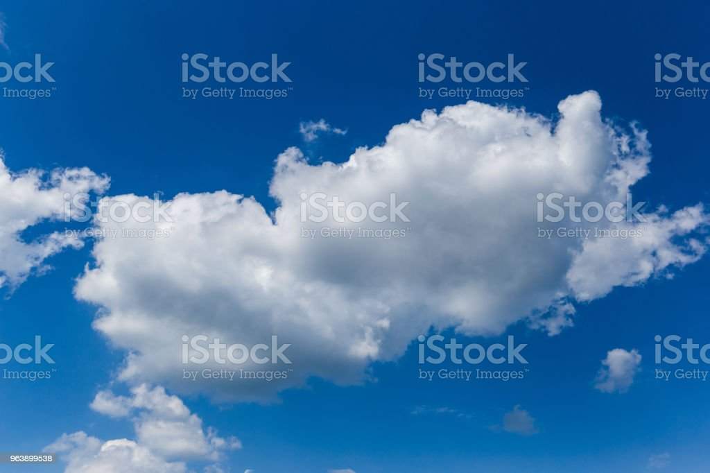 Bursting white clouds in a clear blue sky - Royalty-free Atmosphere Stock Photo