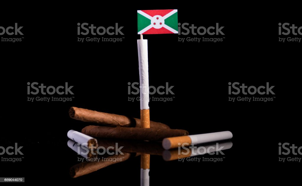 Burundian flag with cigarettes and cigars. Tobacco Industry concept. stock photo