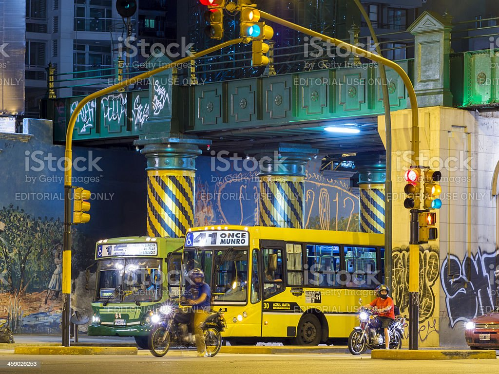Bus and Motocycle at Traffic Light, Buenos Aires, Argentina royalty-free stock photo