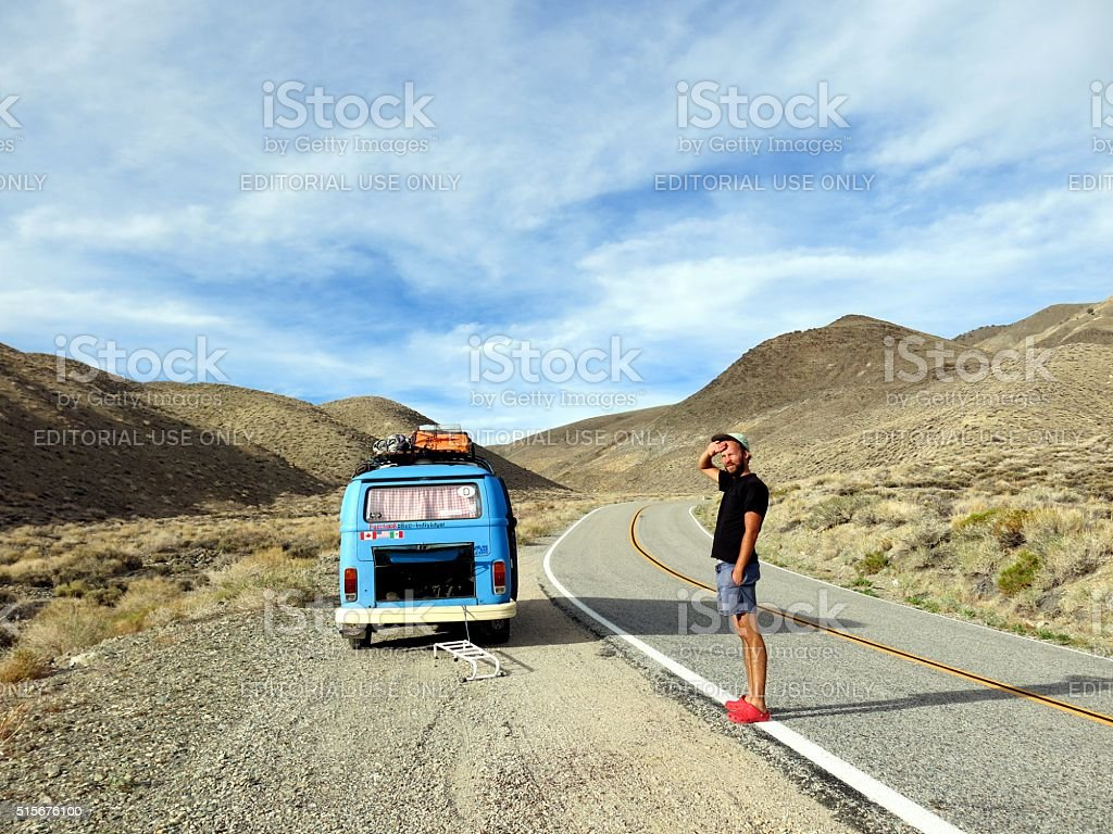 VW bus and owner overheating on mountain pass in california stock photo