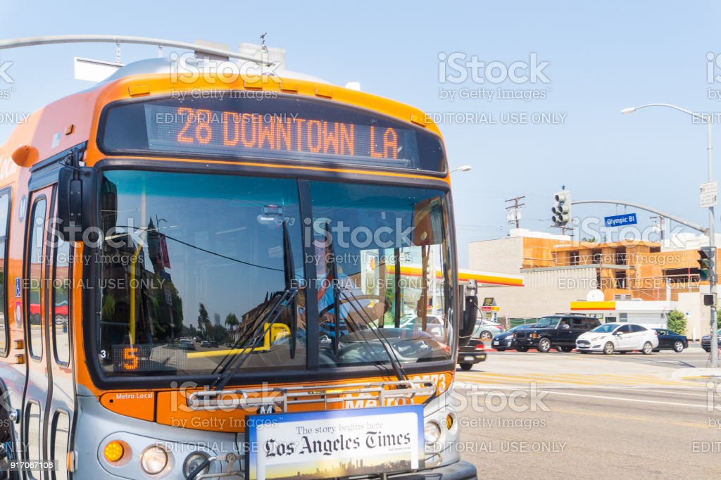 Bus approaching station and stop in Olympic Boulevard in Beverly Hills. stock photo