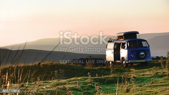 While exploring England in our Volkswagen Camper from 1973, we stayed for one night on top of a mountain in the yorkshire dales national park. When the sun set above the foggy valley, it created this beautiful scenery.