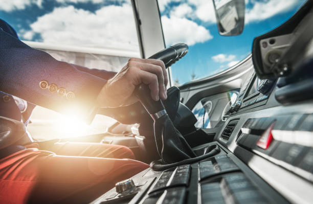 Bus Driver Behind Wheel Changing Gears. stock photo