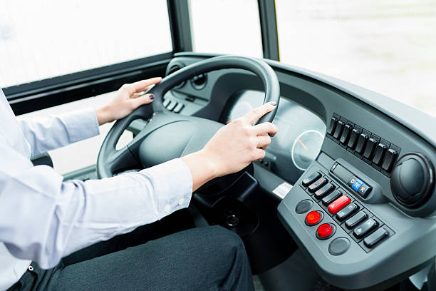 Bus driver in cockpit at the wheel driving stock photo