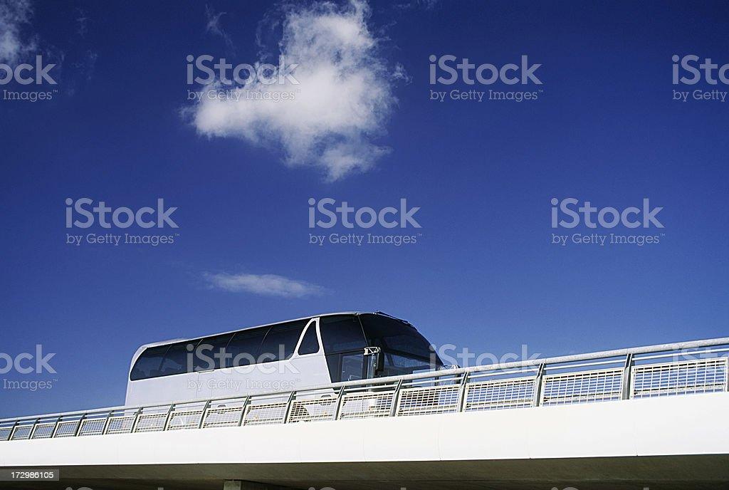 Bus driving across a bridge royalty-free stock photo