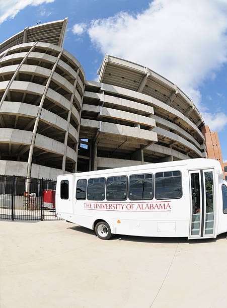 Bus for The University of Alabama by Bryant-Denny Stadium stock photo
