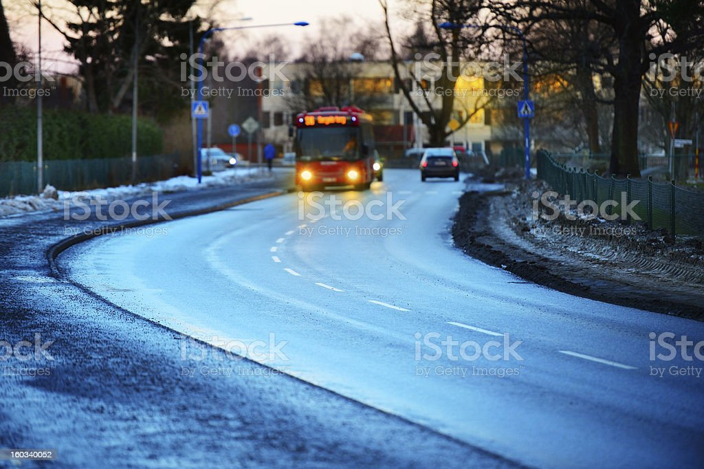 Bus in background, shallow DOF. Rain wet street. royalty-free stock photo