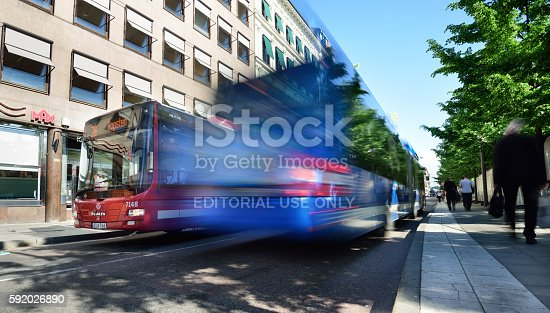 1060957508istockphoto Bus in city, motion blur 592026890
