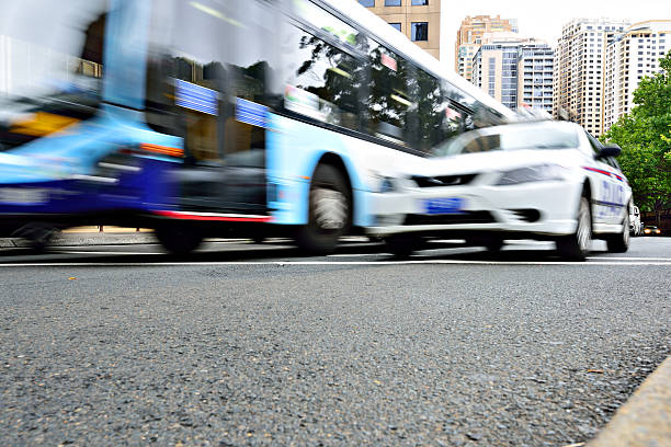 Bus in city traffic, motion blur, police car in Sydney stock photo