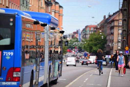 1060957508 istock photo Bus in city traffic 594061988