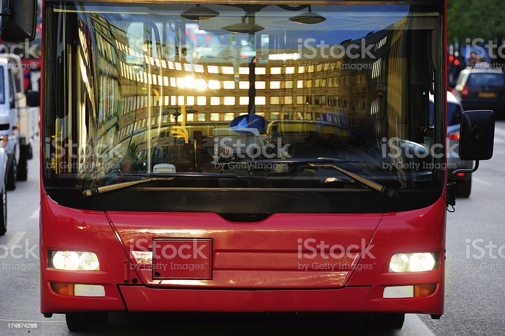 Bus in the city, double reflection royalty-free stock photo