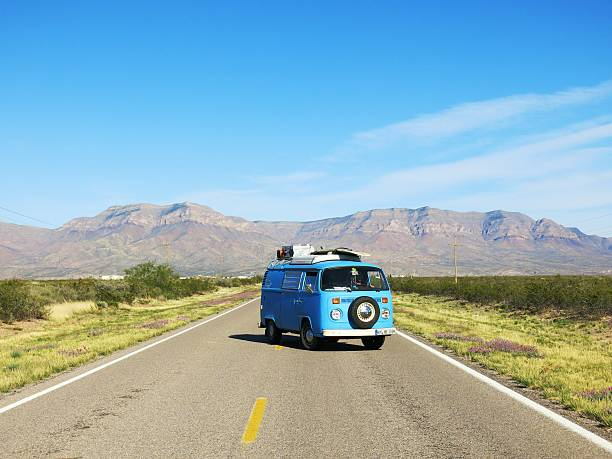 VW Bus on Highway in New Mexico, USA Las Cruces, USA - December 15, 2015: A blue VW Bus from Germany stopped on a Highway in spring in New Mexico north rhine westphalia stock pictures, royalty-free photos & images