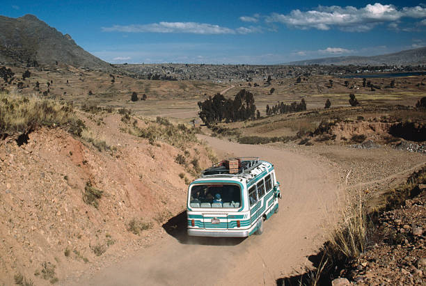 Bus on rural road in near Copacabana Bolivia stock photo