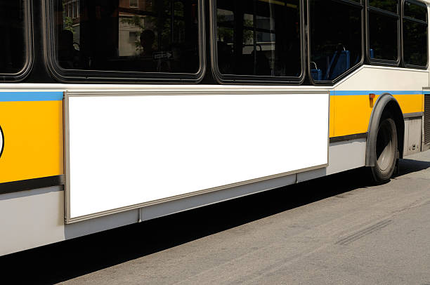 Bus on the road with a blank billboard Blank billboard on bus side. Outdoor advertisement close-up. commercial sign stock pictures, royalty-free photos & images