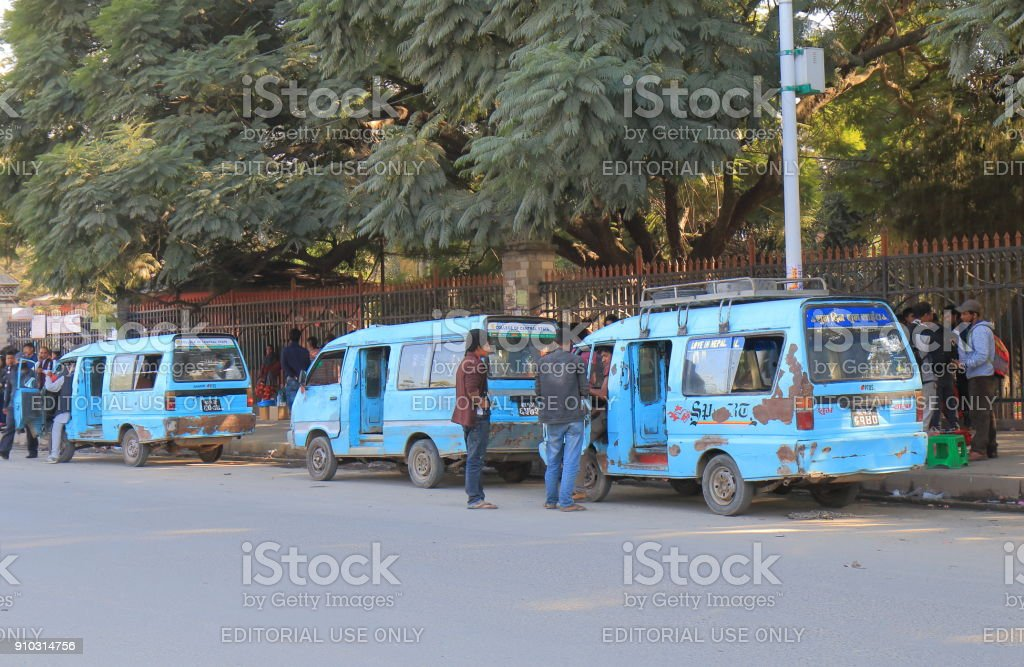 People travel by local mini bus in Kathmandu Nepal.