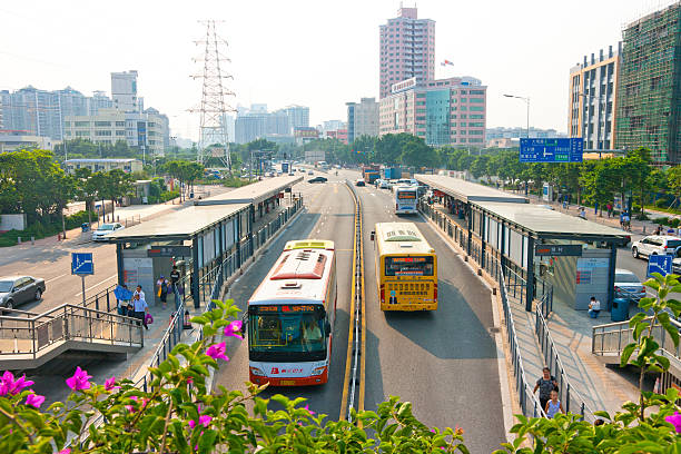 Bus Rapid Transit(BRT) in Guangzhou Guangzhou, China - August 5, 2011: Bus Rapid Transit(BRT) in Guangzhou .This is a mass transit way,One hour can accommodate more than 4,000 people. bus rapid transit stock pictures, royalty-free photos & images