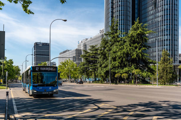 Bus running by financial district of Madrid stock photo
