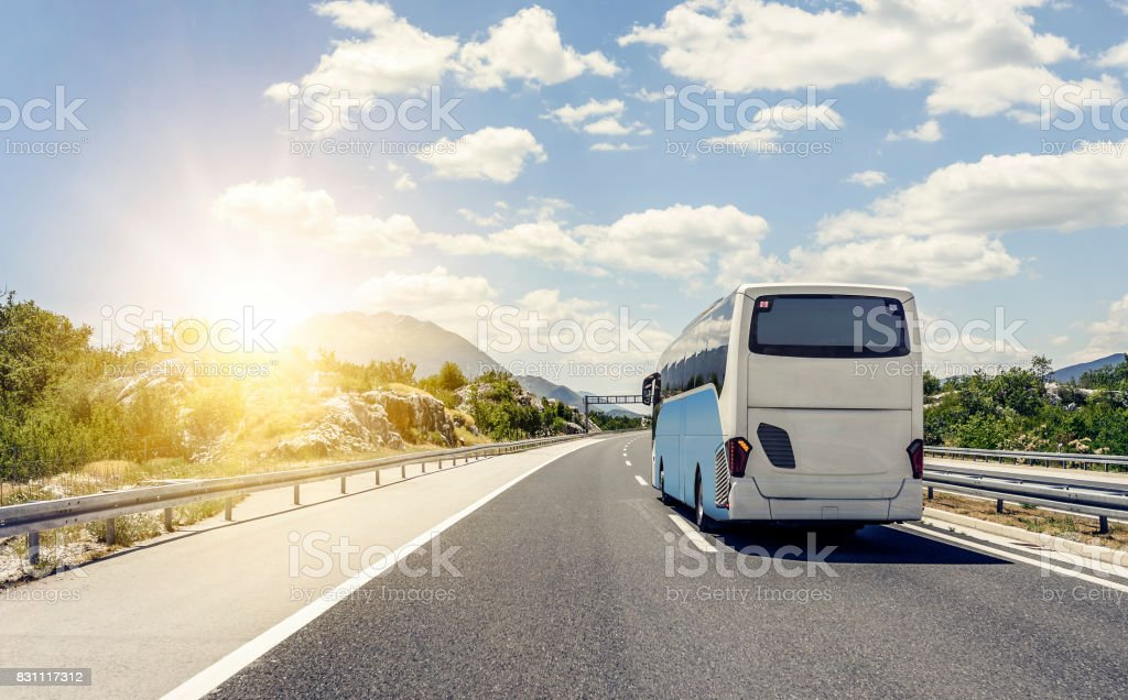 Bus rushes along the asphalt high-speed highway stock photo