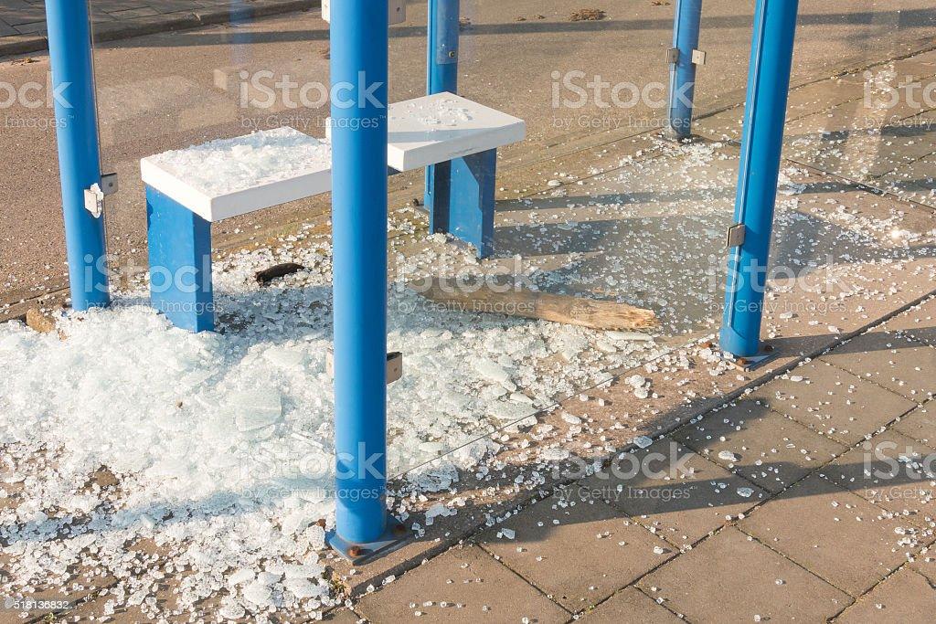 Bus shelter broken by vandals. stock photo