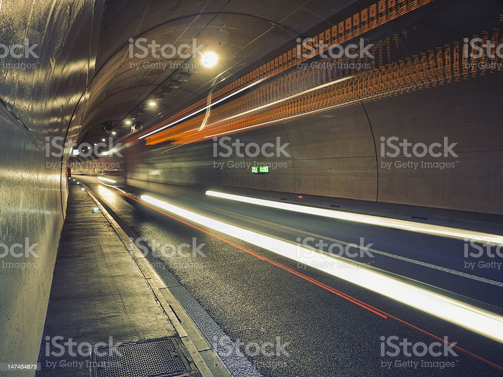 Bus speeding through the tunnel royalty-free stock photo